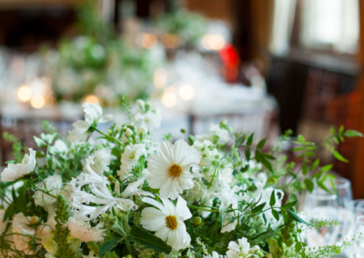 White flowers amongst green leaves - table decoration