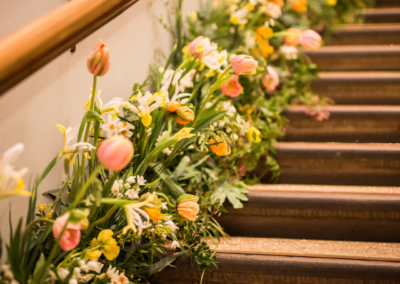 Flowers going up the side of stairway
